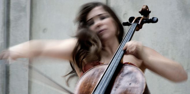 Alisa Weilerstein in motion playing the cello